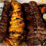 MAY 21, 2010 - ROSLYN HEIGHTS, NY: Ravagh Persian Grill, located at 210 Mineola Avenue in Roslyn Heights, offers a variety of popular Middle Eastern dishes such as assorted kebabs, shown alongside basmati rice, humus and babaganoosh. (Dave Sanders for the New York Times)                              NYTCREDIT: Dave Sanders for The New York Times